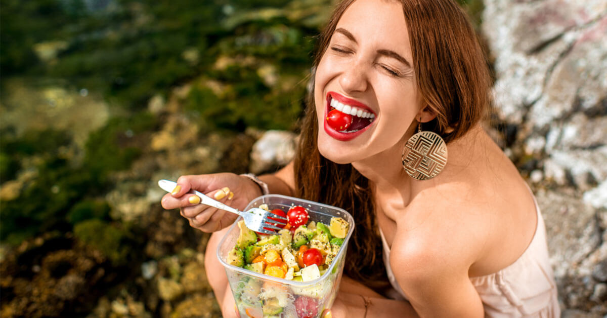 image of woman enjoying the best roma tomato ever