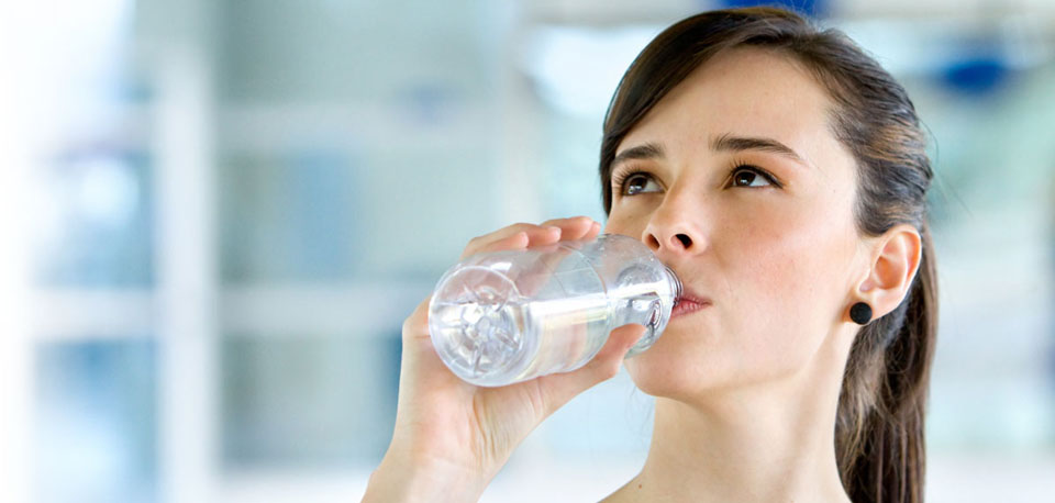 image of woman drinking water