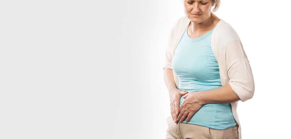 image of woman with severe lower stomach pain